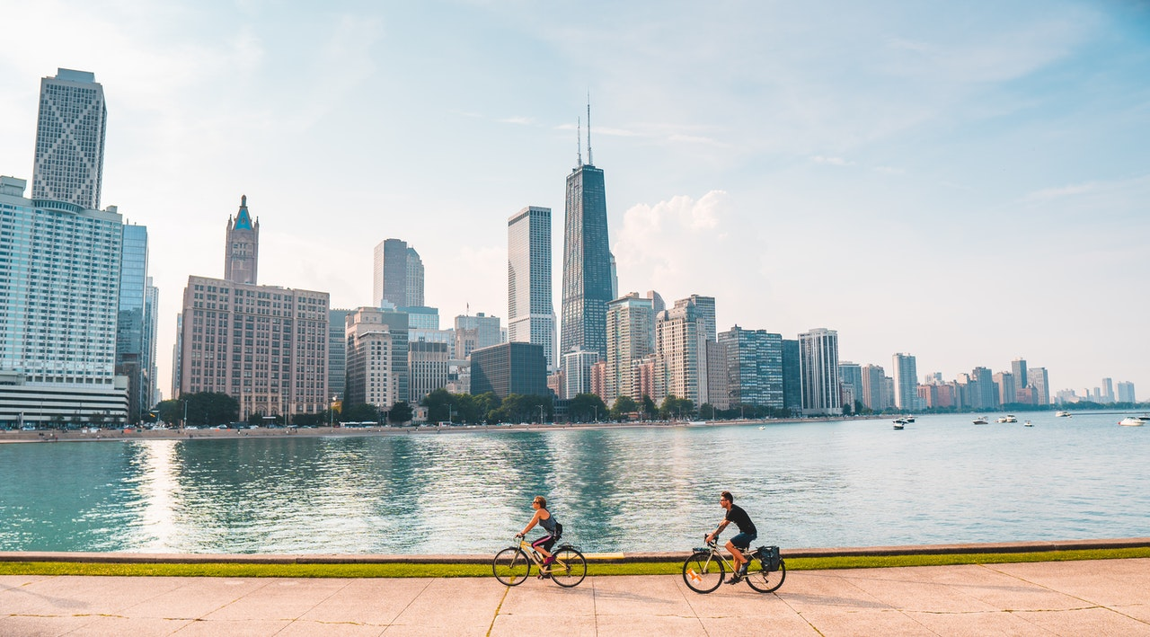 Couple on bikes riding through Chicago neighborhood
